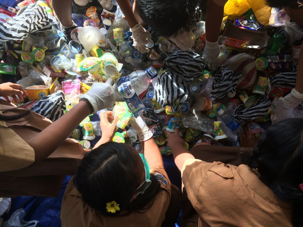 Kids sorting plastic