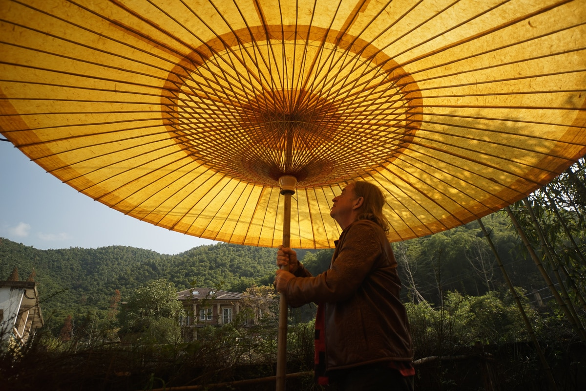 John with bamboo umbrella